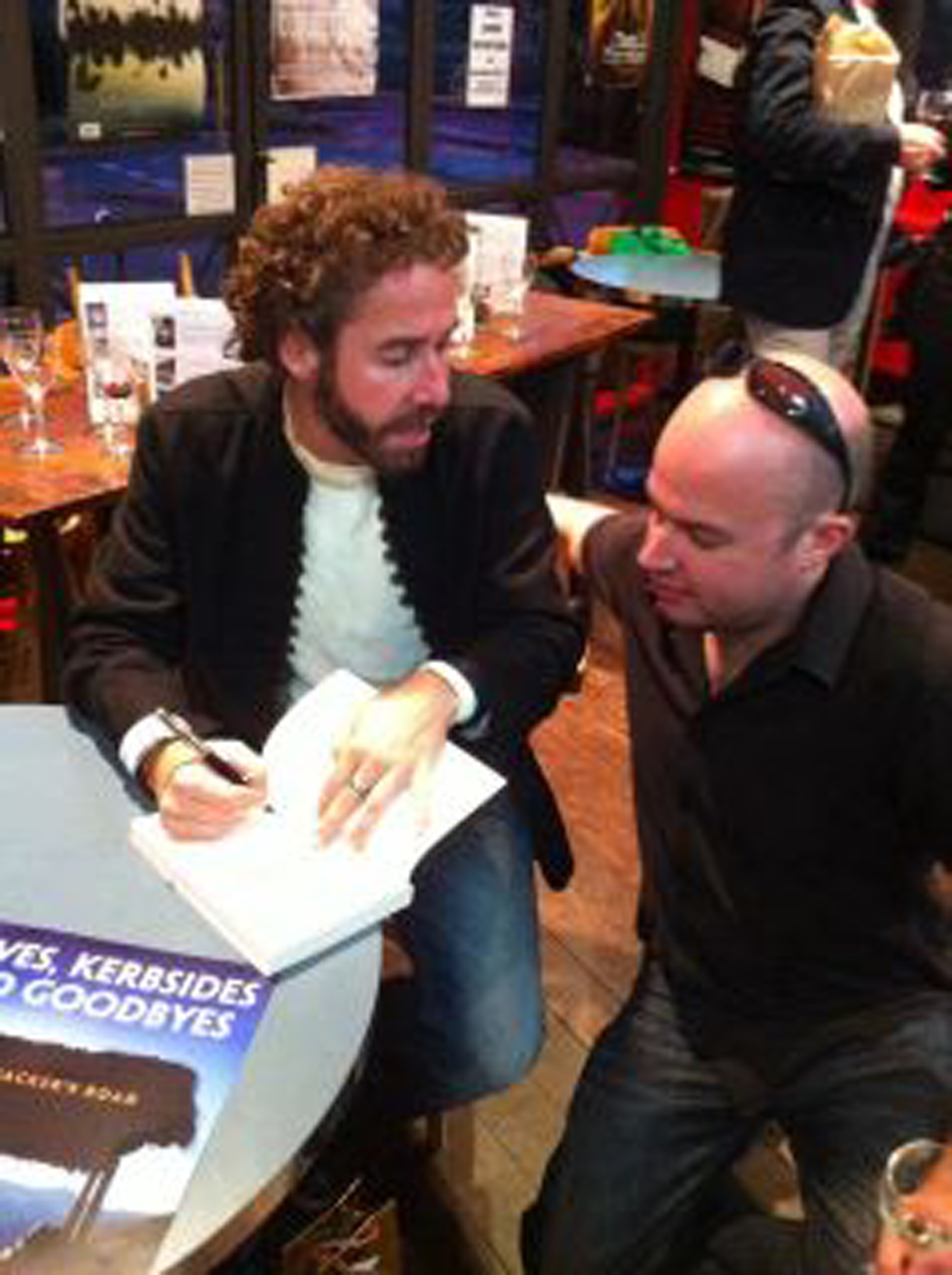 David signs a copy for his best friend Chris