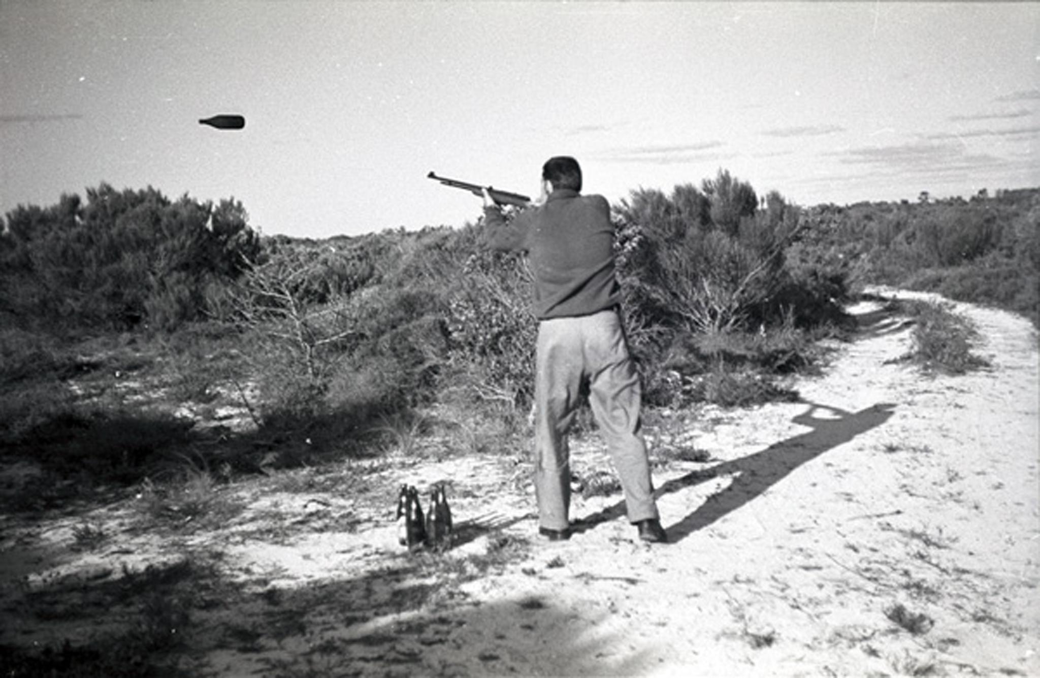 Dad shooting long neck pigeons