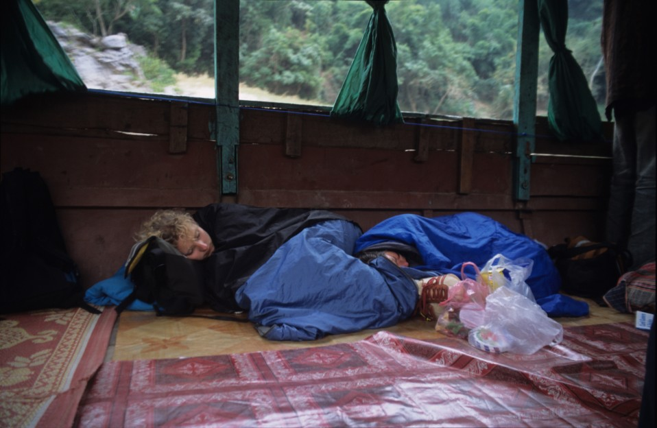 Backpackers Rest on the Boat Ride from Luang Prabang to Houay Xai
