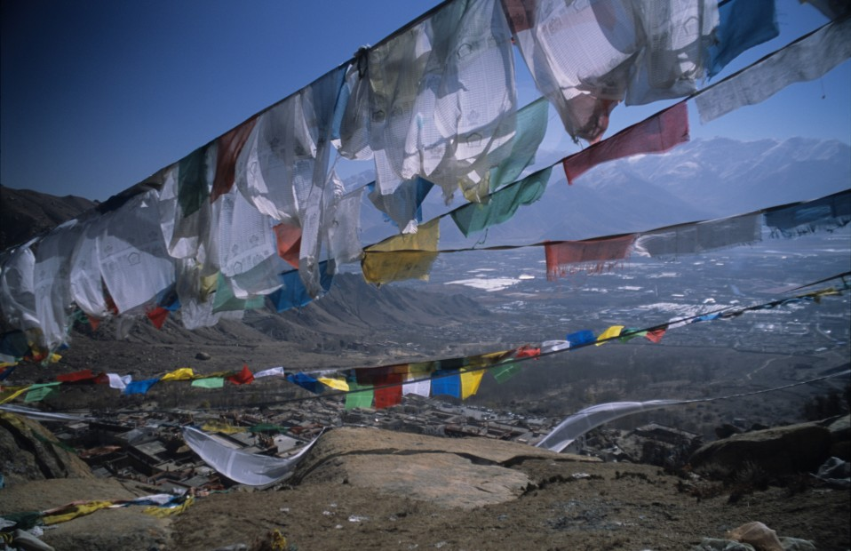 Monastic View Through Prayer Flags of Lhasa